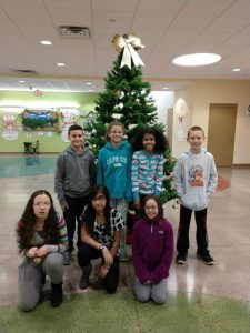 """EverGreen's 5th grade student council decorating a """"Wildcat Pride"""" tree"""